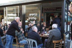 Men enjoying fellowship and tea.